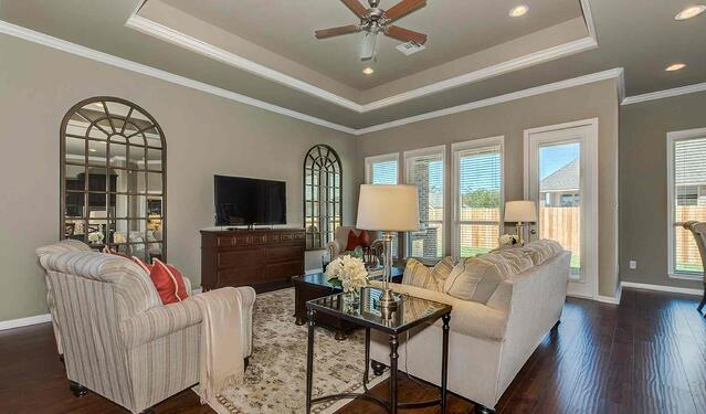 family room with furniture in castlegate ii model home