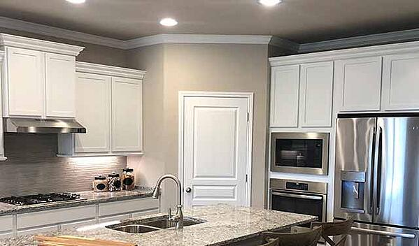 kitchen-white-cabinets-stainless-appliances